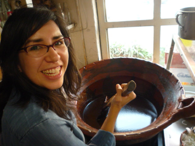 Lesley stirring a mole pot in Mexico City