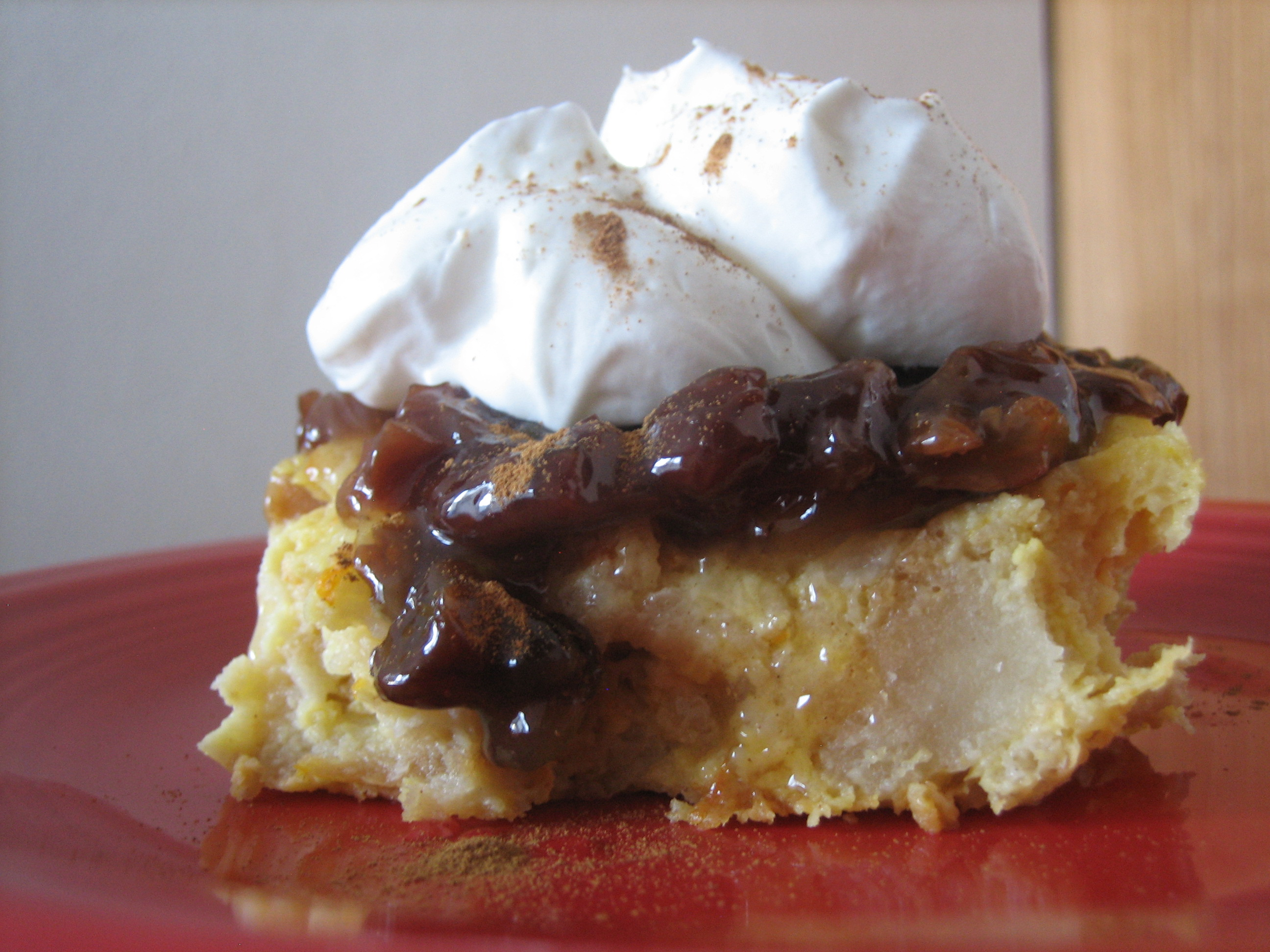 Orange bread pudding with gooey raisin sauce
