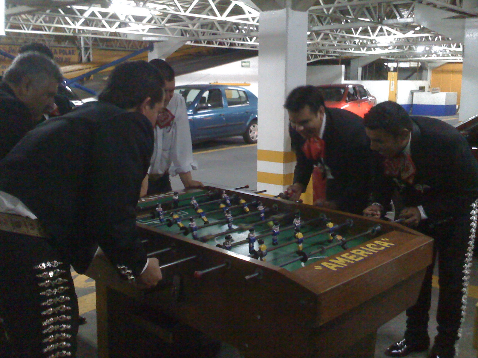 Mariachis playing foosball