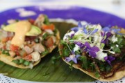 A tostada topped with edible flowers from Nicos, a Mexico City restaurant.
